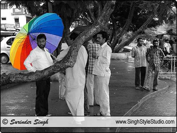 Color Umbrella in Rain : Street People Black and White Photography, India.