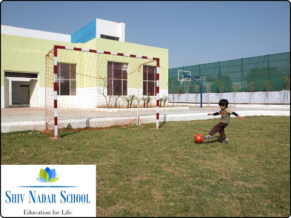 Kid playing Football Institutional Photography Shiv Nadar School Gurgaon Haryana India